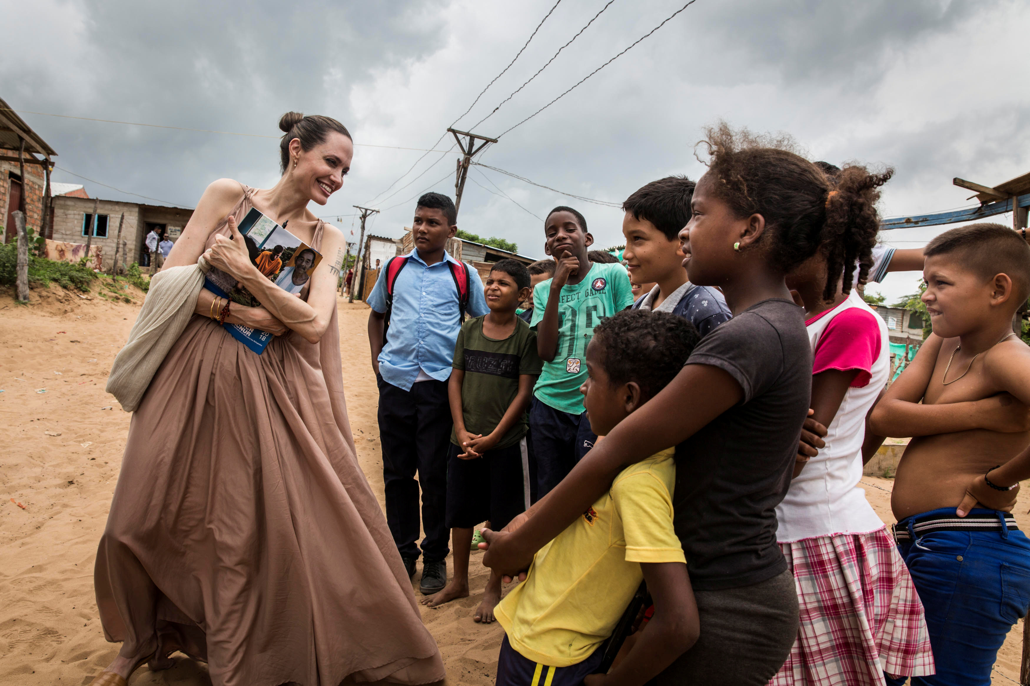 Special envoy for the United Nations High Commissioner for Refugees Angelina Jolie speaks to people in Riohacha, Colombia June 7, 2019. Picture taken June 7, 2019. Courtesy of UNHCR/Andrew McConnell/Handout via REUTERS