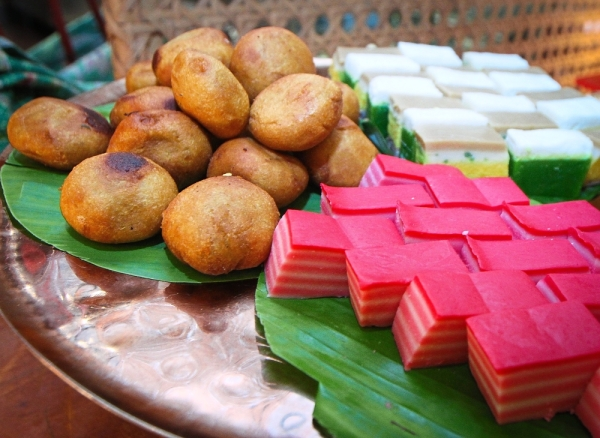 Traditional Malay kuih such as (clockwise from top left) cucur badak, kuih talam and kuih lapis are also available.
