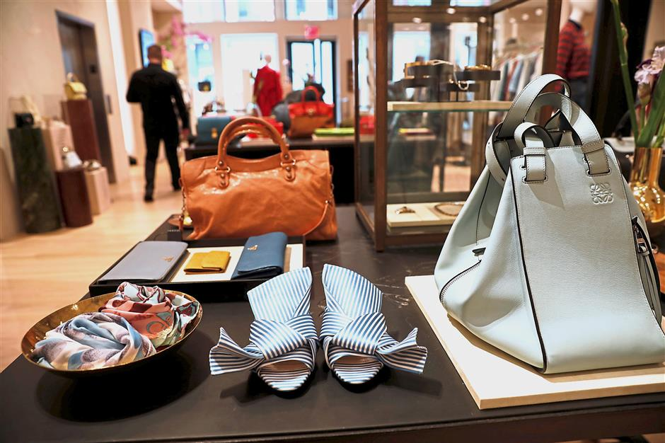 Physical presence: Luxury shoes and accessories for sale are displayed at The RealReal shop in New York City. u2014 Reuters