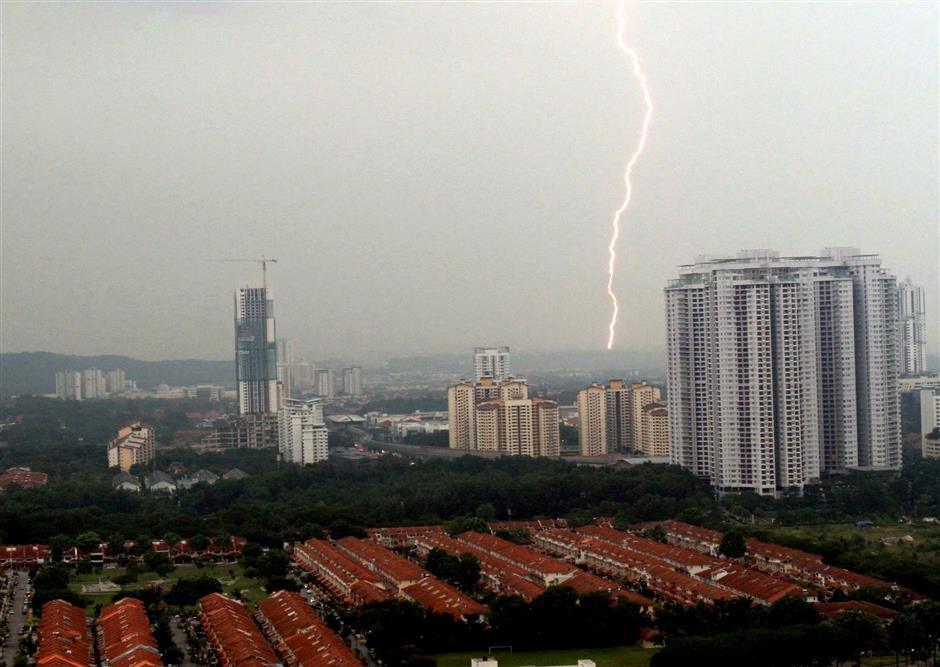 Lightning never strikes twice in the same place. Taken at Kota Damansara at 4 pm