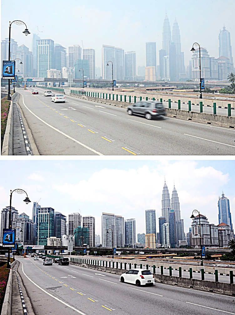 A welcome sight: The photo above showing hazy conditions in the Kuala Lumpur city centre while the photo below shows a clearer view after the rain. - Bernama
