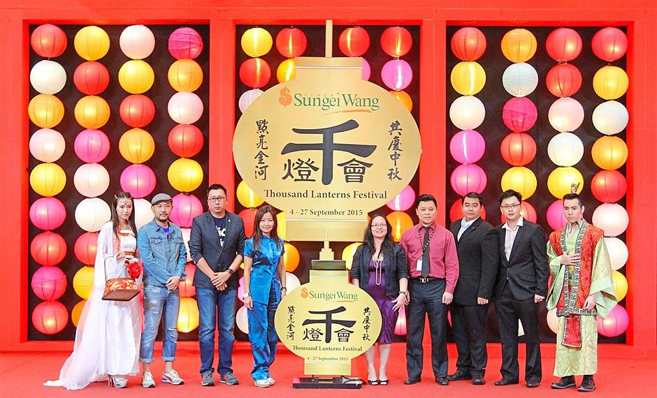 1 Sungei Wang Complex Manager Yuen May Chee (fifth right) and Magnum 4d Berhad Operation Head Stephanie Ang (fourth left) with ONFM ON Connection Sdn Bhd Director Ryan Leow(2nd left), Mega Ultimate Business Development Director Wong Wei Chong (3rd left), ENE (Selangor) Sdn Bhd State Manager Lim See Chin (fourth right), HCR Event Solutions Director Eric Yap ((3rd right) and Sungei Wang Head of Marketing & Communication Joseph Teo (2nd Right) taking a group picture after the official launch the Thousand Lanterns Festival at Sungei Wang Plaza in Kuala Lumpur, yesterday. MUHAMAD SHAHRIL ROSLI/The Star.