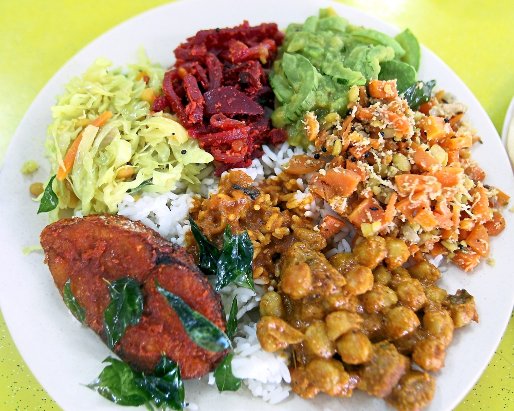 Five Star Curry House has a variety of vegetables including stir fried cabbage, beetroot, snake gourd koottu, and carrots stir fried with dhal and desicated coconuts as well as chickpea masala.