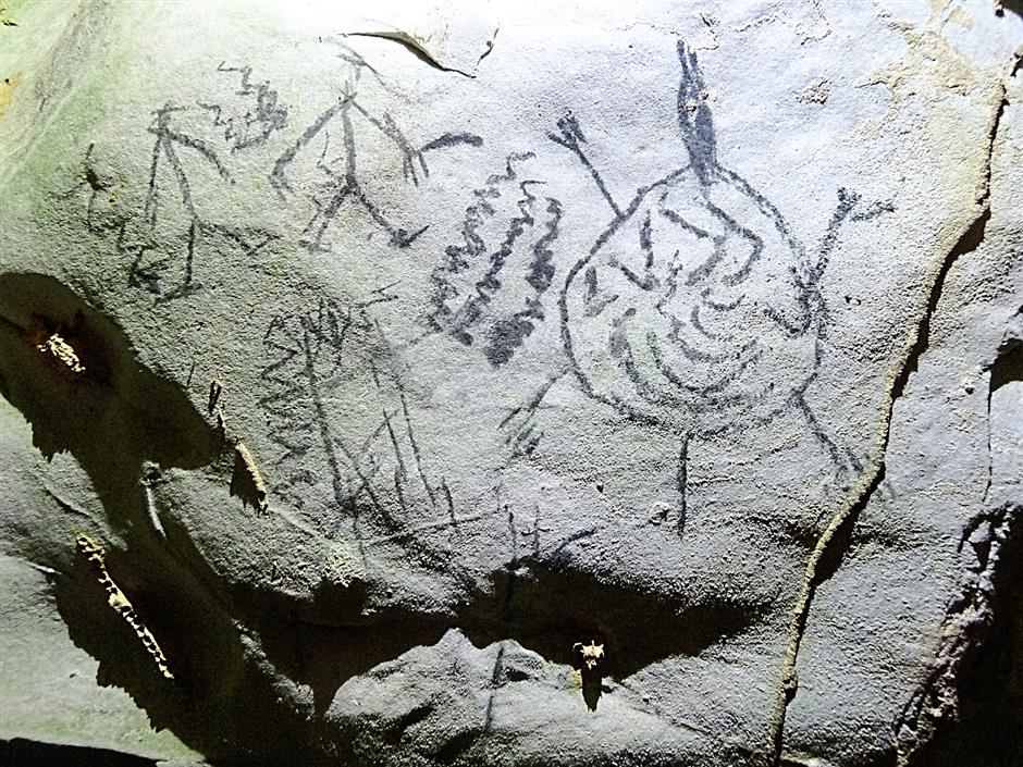 There's a whole lot of things going on here. It would be fascinating to uncover the stories behind these cave drawings in Merapoh.