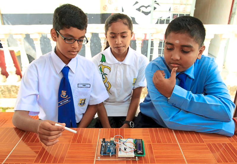 EMBEDDED IN SCHOOLS: Secondary school students at a Raspberry Pi class-  (L-R) Tines Subramanian, Yurveiina Thilagarajan and Thayalan Ramasamy.