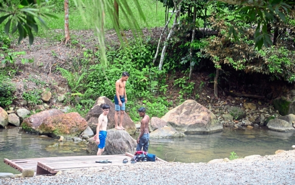 Picnickers enjoying themselves at the Gunung Pulai Forest Reserve.