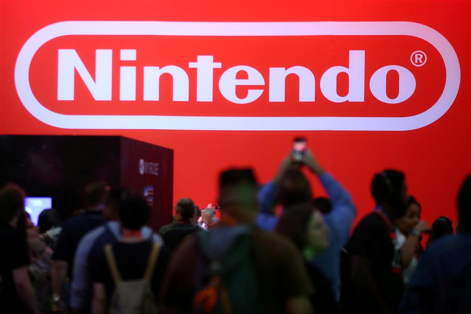 FILE PHOTO - The Nintendo booth is shown at the E3 2017 Electronic Entertainment Expo in Los Angeles, California, U.S. June 13, 2017.  REUTERS/ Mike Blake/File Photo   GLOBAL BUSINESS WEEK AHEAD