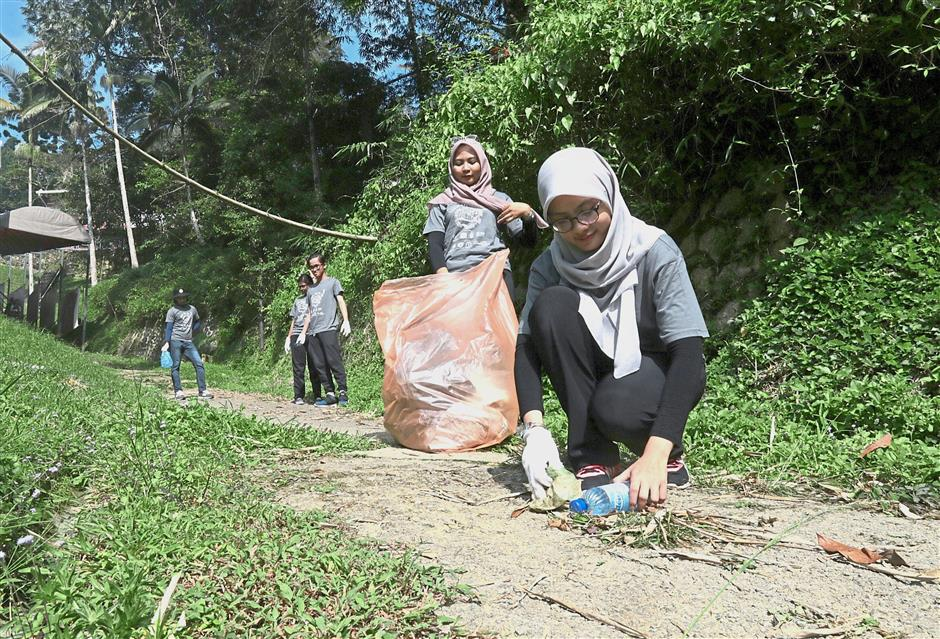 Volunteers picking up rubbish along one of the trails.