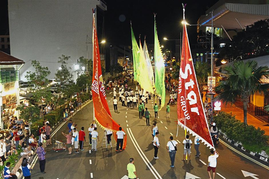Giant flags are among the main highlights of the procession.