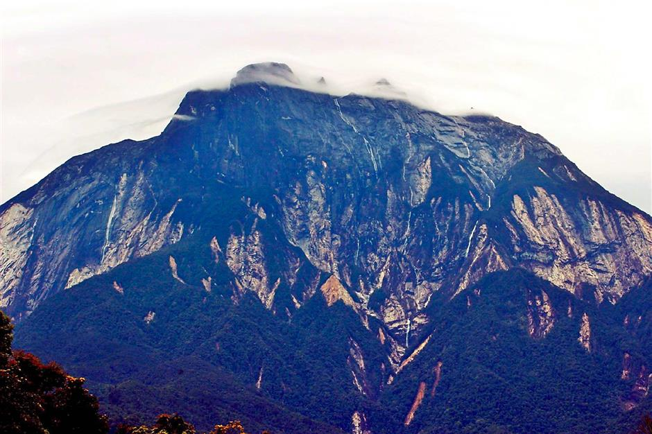 Heartbreaking sight: Locals are saddened to see Mount Kinabalu without its greenery and granite face.