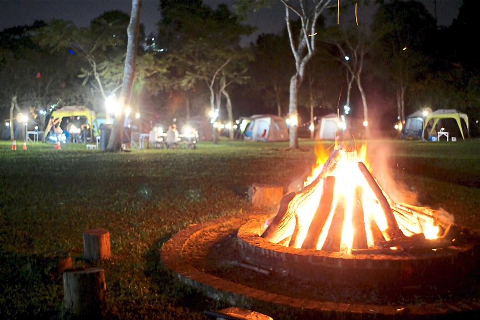Circle of light: A bonfire burning all night long at the campsite.