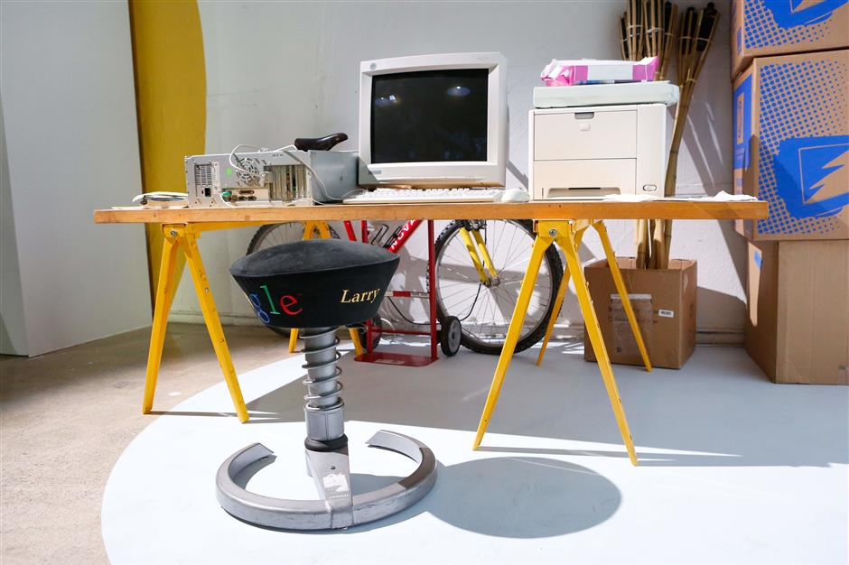 Google co-founder Larry Page's original stool and desk are displayed at Google Search's 20th Anniversary Event on September 23, 2018 in San Francisco, California. (Photo by Amy Osborne / AFP)