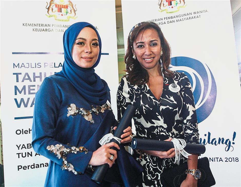 Woman power: Vivy (left) and Tengku Zatashah at the launch of the Women Empowerment Year 2018.