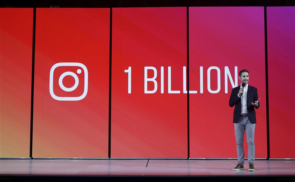 In this Tuesday, June 19, 2018, photo Kevin Systrom, CEO and co-founder of Instagram, prepares for Wednesday\'s announcement about IGTV in San Francisco. Facebooku2019s Instagram app is loosening its restraints on video with a new channel that will attempt to lure younger viewers away from Googleu2019s YouTube and pave the way to sell more advertising. (AP Photo/Jeff Chiu)