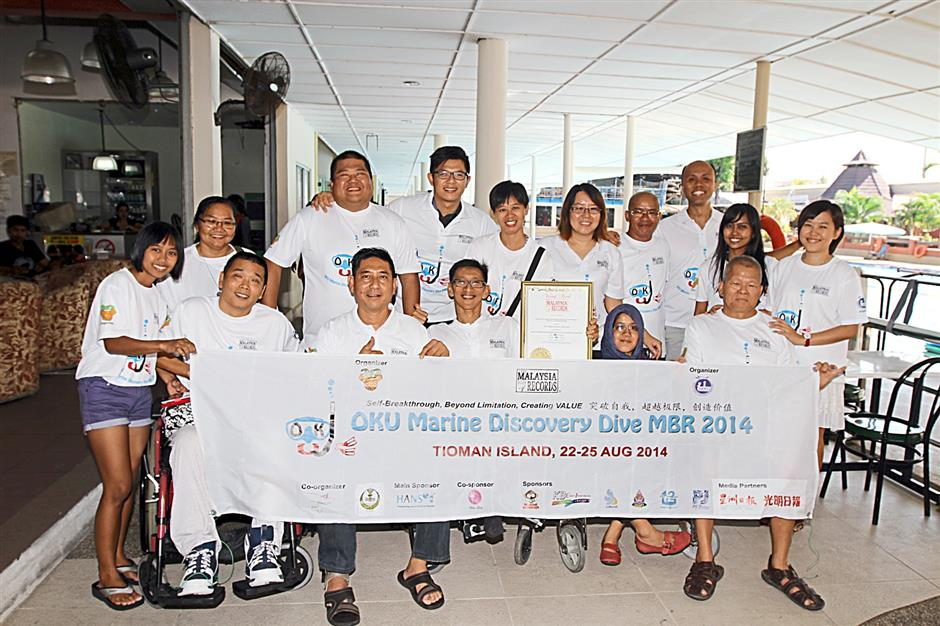With the help of volunteers, 29 differently-abled individuals were able to enter the Malaysia Book of Records for most number of disabled participants in a scuba diving expedition