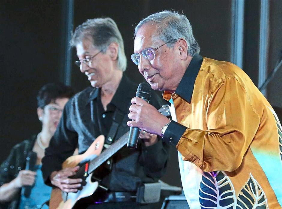 Happy find: Adenan singing during Sarawak Forestry Corporation's 12th anniversary celebration. He announced the cave's discovery at the event.