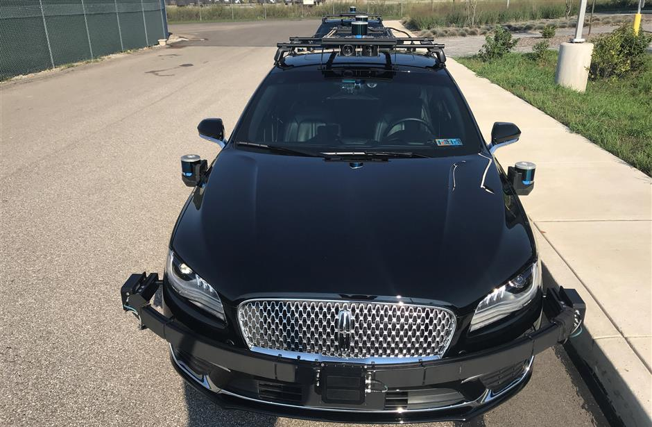 An Aurora self-driving Lincoln MKZ car is seen outside the companyu2019s office in the Lawrenceville neighborhood in Pittsburgh, Pennsylvania, U.S., September 21, 2018. Picture taken on September 21, 2018.   REUTERS/Heather Somerville