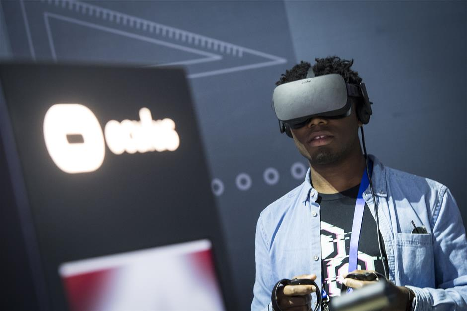 An attendee wears an Oculus VR Inc. Rift virtual reality headset during the F8 Developers Conference in San Jose, California, U.S., on Tuesday, May 1, 2018. Zuckerberg said that he learned, while testifying in front of Congress last month, that he didn\'t have clear enough answers to questions about data and Facebook should offer users this kind of option to control their information. Photographer: David Paul Morris/Bloomberg