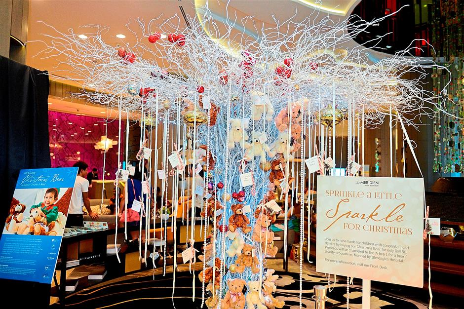 Le Meridien Kuala Lumpur's Christmas Wishing Tree. The names of child patients from Gleneagles Hospital are hung on the tree so that guests can pick a name and buy a Christmas present for the child.