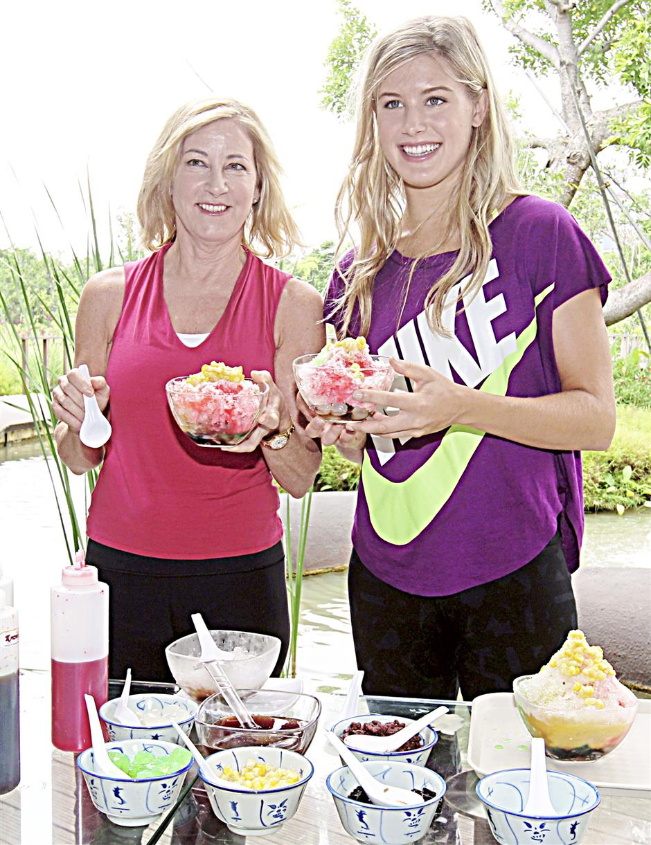 Cool as ice: American legend Chris Evert and young Canadian star Eugenie Bouchard showing off their self made ice kacang in Singapore recently. Both were in Singapore to promote the WTA Championships there in October.