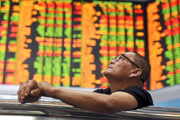 Not bullish: The FBM KLCI is trading at levels that only those who believe in musical chairs will understand. When one looks beyond the FBM KLCI, a lot of stocks have plunged. — AP