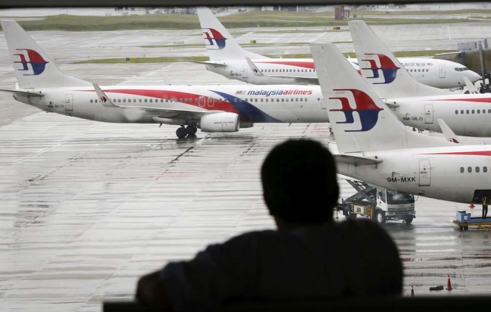 A file picture of a visitor looking out from the KLIA viewing gallery on May 27, 2014. u2013 AP