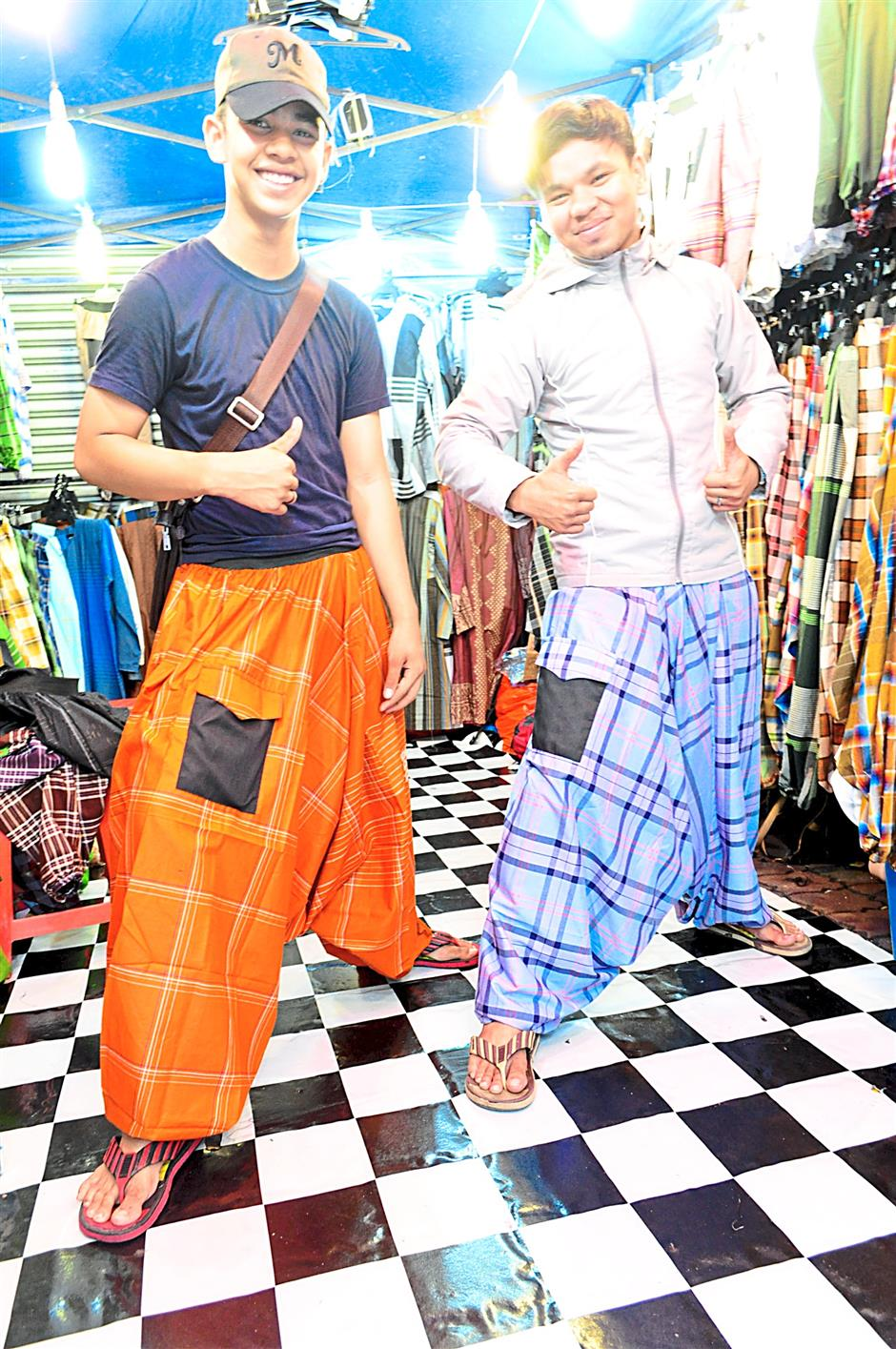 Arif (right) is trying his luck as a self-financed entrepreneur for the first time this Ramadan.