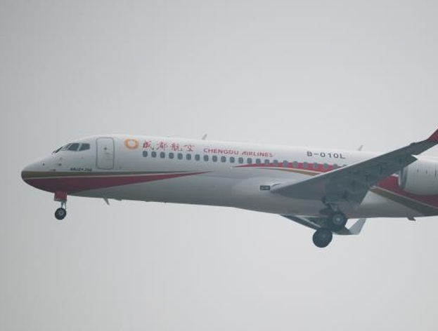 Commercial Aircraft Corp of China\'s (COMAC) ARJ 21-700 regional jet performs at the Airshow China 2014 in Zhuhai, south China\'s Guangdong province on Nov 11, 2014. The official China Daily reported that the country\'s civil aviation regulator has given the green light for the plane go into service - AFP Photo.