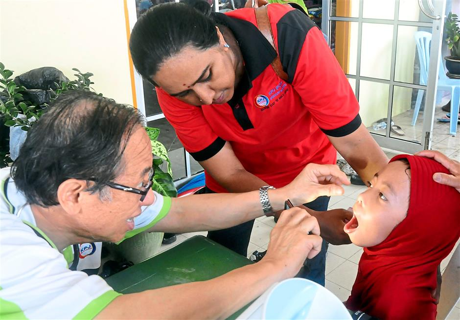 Up close: A young flood victim receiving medical attention.