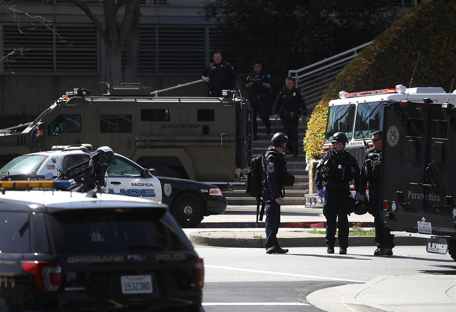 SAN BRUNO, CA - APRIL 03: Police walk outside of the YouTube headquarters on April 3, 2018 in San Bruno, California. Police are investigating an active shooter incident at YouTube headquarters that has left at least one person dead and several wounded.   Justin Sullivan/Getty Images/AFP == FOR NEWSPAPERS, INTERNET, TELCOS & TELEVISION USE ONLY ==