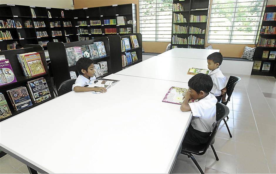 Children of the Rumah Aman 2 home in Sungai Buloh reading in their library