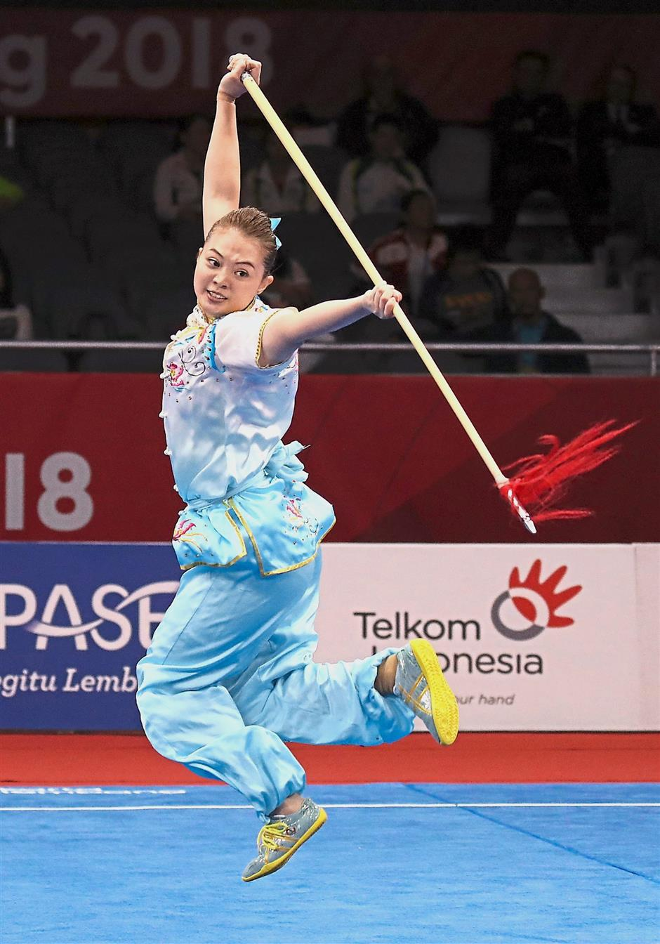 Serious business: Phoon Eyin in action during the womenu2019s qiangshu routine in Kemayoran yesterday.