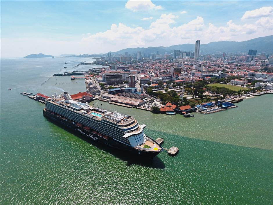 Larger than life: The u2018Mein Schiff 3u2019 docking at the Swettenham Pier Cruise Terminal in George Town.
