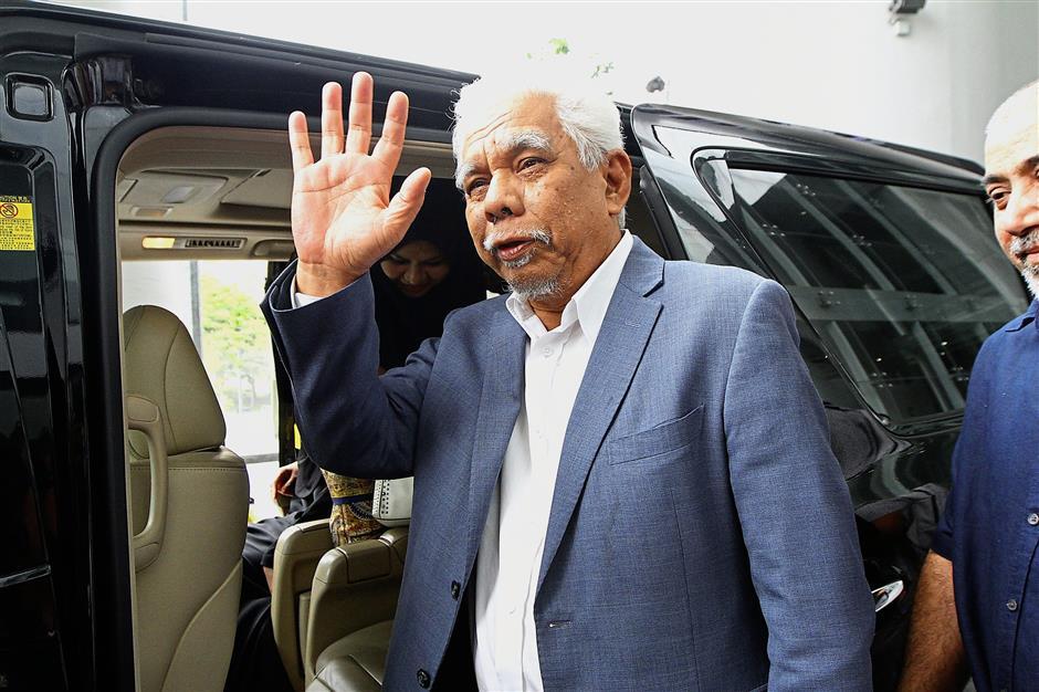 Making his exit: Rameli waving to reporters as he leaves the MACC headquarters in Putrajaya.