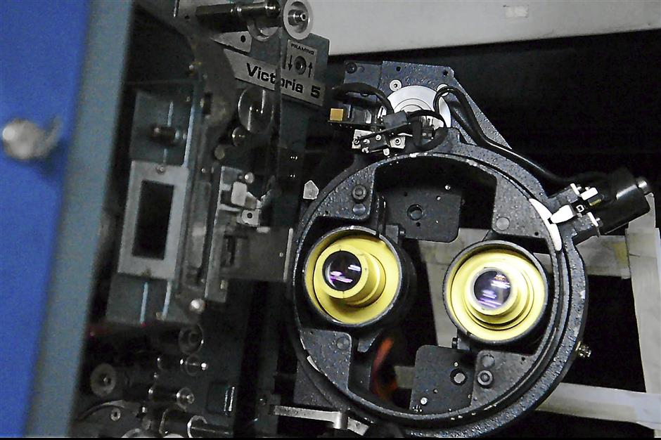 Two lenses: a view of a traditional film projector -- the two lenses need to be switched depending on the aspect ratio that the movie was shot in. Modern digital projectors don't need different lenses because the aspect ratio is encoded right into the digital file