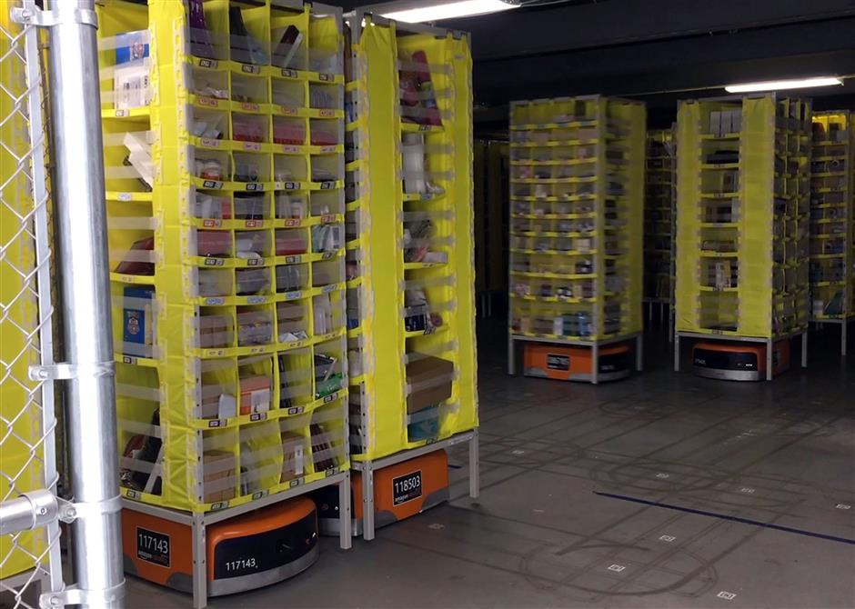 The Amazon fulfillment center in Monee, Ill, uses robots to help workers fulfill orders. The robots, which lift stacks of products and move them to a worker, are seen on Wednesday, March 28, 2018.(Terrence Antonio James/Chicago Tribune/TNS)