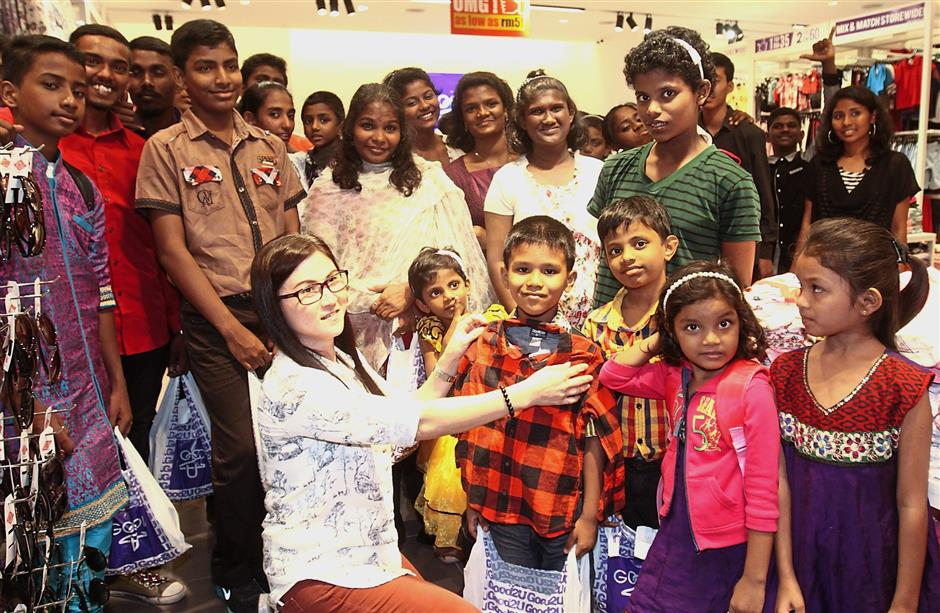 Children from Destiny Starting Point, Klang, were sponsored clothes worth RM3,000 by Good2U at Sunway Putra Mall.