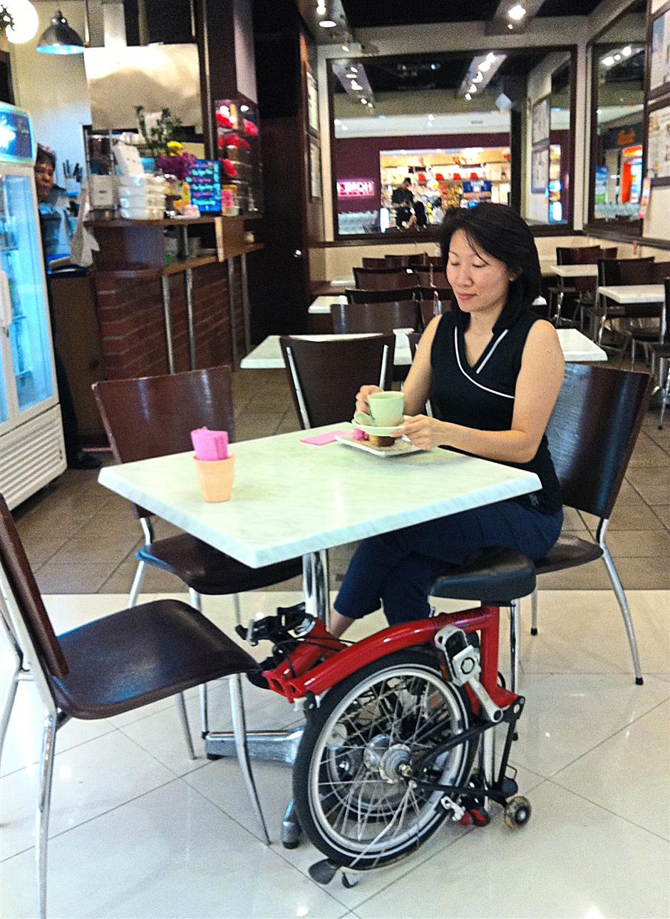 Pauline Lee wheels her bike straight into a café, folds it up and tucks it under the table.
