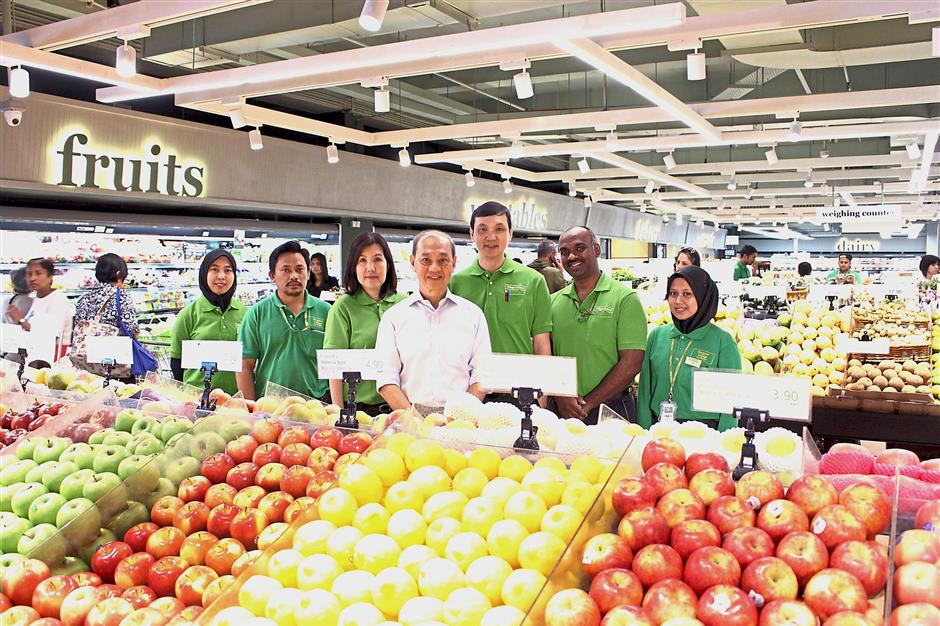 Staying in touch: Ong (centre) still visits the outlets to get to know the customers and his staff.