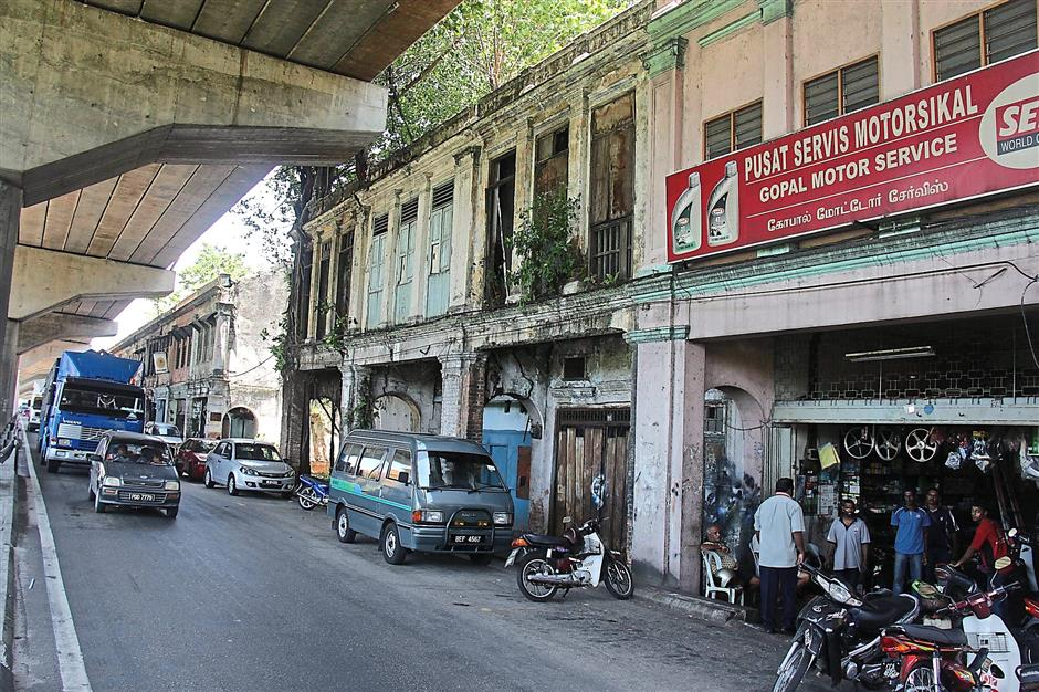 Left to rot: The elevated highway on the left has often been blamed for causing Jalan Kem's fall into neglect. — filepic