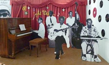 <b>Band on the boards:</b> The life-size standees of (from left) Jimmy Boyle, Austin Rajamoney, Larry Rodrigues, Max Fletcher and Joe Rozells are one of the most eye catching displays at <i>Penangu2019s Popular Music of the 1940s, 1950s and 1960s</i> exhibition.