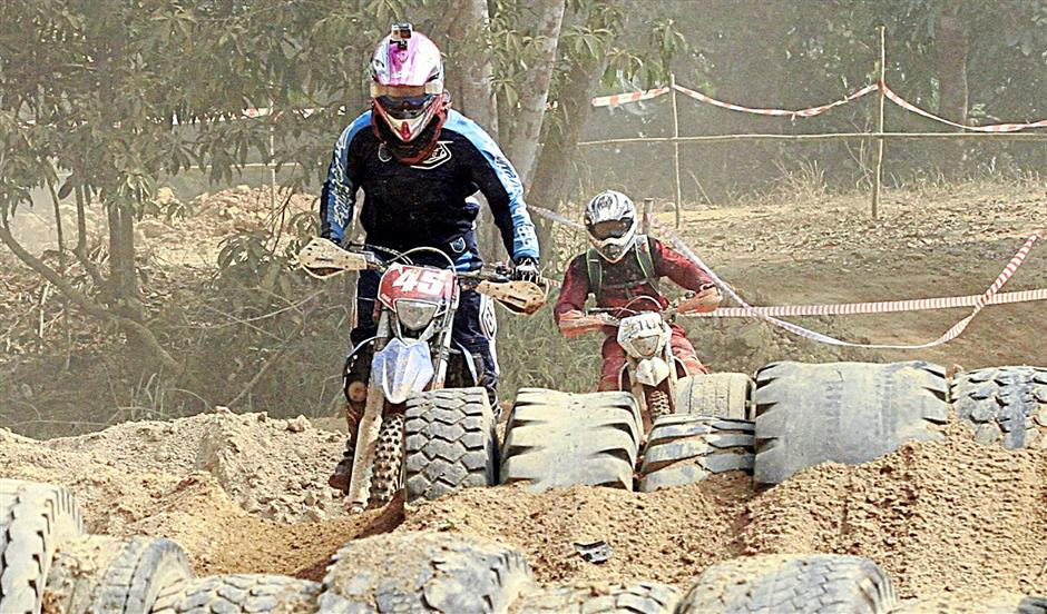 A  participant  going through the range of unused tyres of the the Piala TA45 Enduro Challenge 2014.