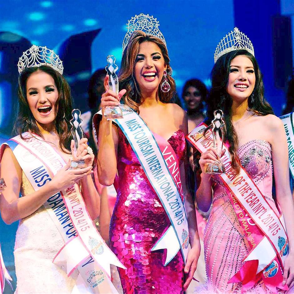 Top three: The newly crowned Miss Tourism International 2014/2015 Faddya Ysabel Halabi Troisi of Venezuela (centre) flanked by the second-placed Miss Tourism Queen of the Year International 2014/2015 Warangkanang Wutthayakorn of Thailand (right) and third-placed Miss Tourism Metropolitan International 2014/2015 Glennifer Perido of the Philippines.