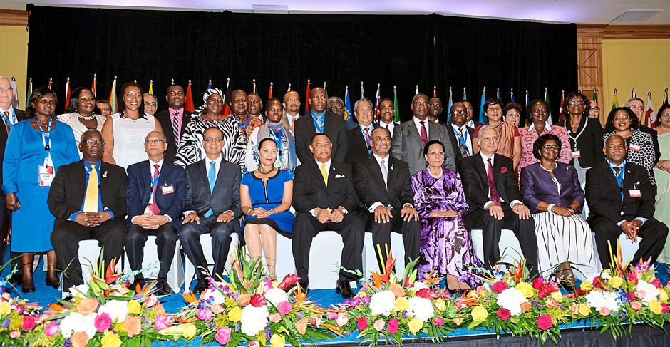 1. International delegation: Muhyiddin (standing, seventh from left) during a group photo with part of the 53 Commonwealth member countries who attended the opening of the 19CCEM in The Bahamas.2. Learning from each other: Muhyiddin and Education director-general Datuk Seri Dr Khair Mohamad Yusof (third and second from left) during a session at the conference. – Bernama photos