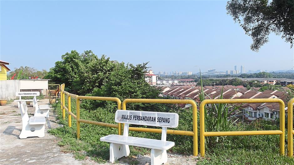 In the pipeline: Sin Dee plans to improve tourism by offering facilities and preserving the heritage. She has started a project with the local council to create a 'lookout point' and mini park atop one of the hills in Kampung Baru Seri Dengkil.