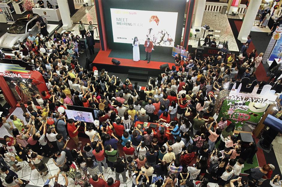 Fans gathering for the meet-and-greet session with Taiwanese TV personality Chen Mei Feng (white dress) at dimsumu2019s u2018Celebrate Asia with Usu2019 event in Penang.