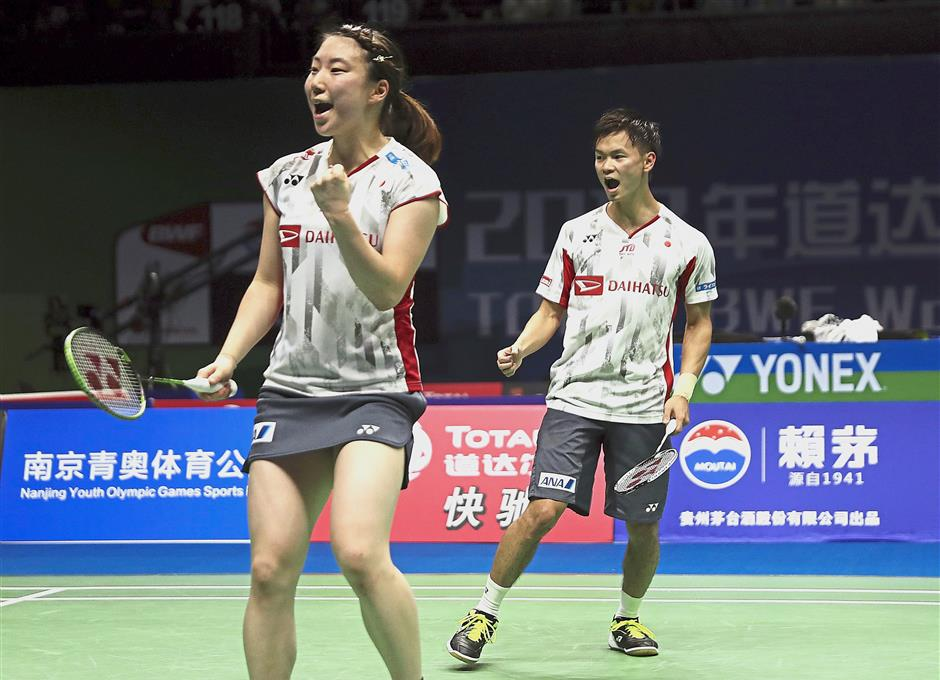 Rising stars: Malaysian coach Jeremy Gan guided Arisa Higashino (left) and Yuta Watanabe to win the All-England title in March. — AP