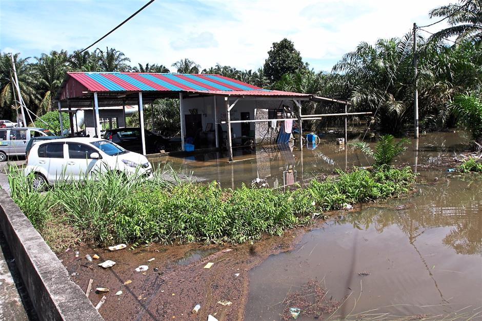 Kampung Changkat Jong was flooded due to the yearly monsoon season and poor water canal system.