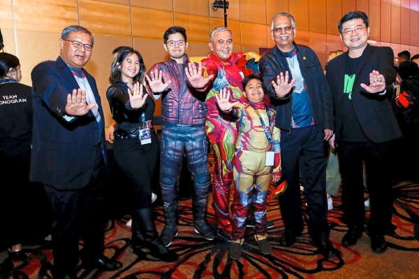 Dressed as Marvel characters (from second left) Raja Zarifah, Raja Muhamad Rafiqe, Raja Mazhar Mohar Tun Raja Mohar and Raja Raziq Isqandar Mohar join (from left) Maybank Community Financial Services Cards & Wealth head of cards Md Gharif Talib, Ravintharan and Visa country manager for Malaysia Ng Kong Boon at the cocktail reception at One World Hotel, Petaling Jaya before the screening of Avengers: End Game.