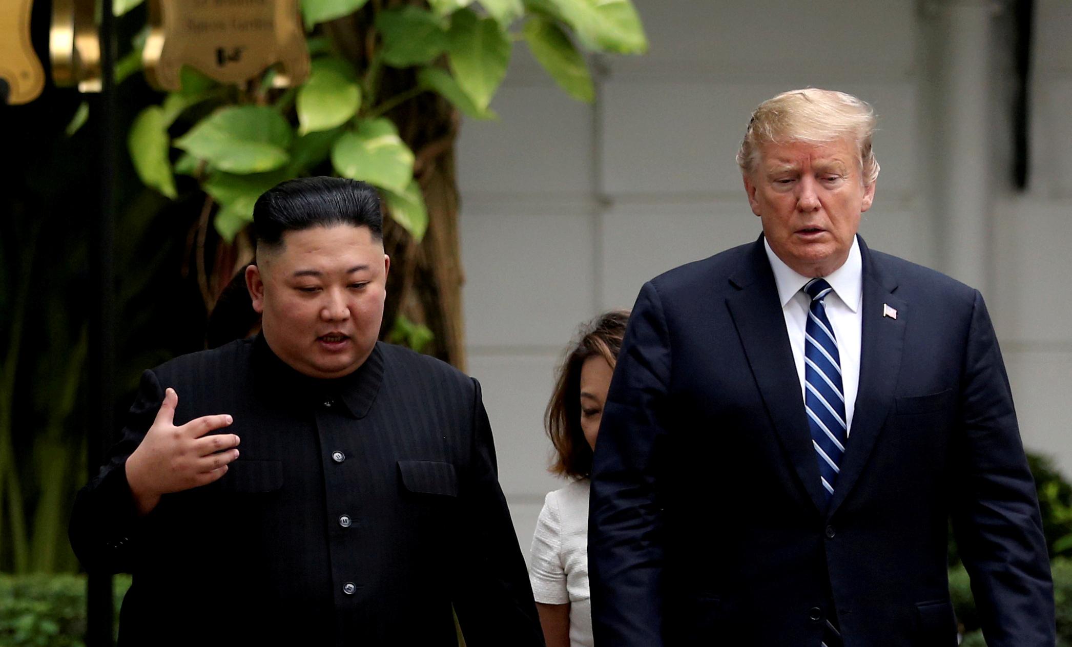 FILE PHOTO: North Korea's leader Kim Jong Un and U.S. President Donald Trump talk in the garden of the Metropole hotel during the second North Korea-U.S. summit in Hanoi, Vietnam February 28, 2019. REUTERS/Leah Millis